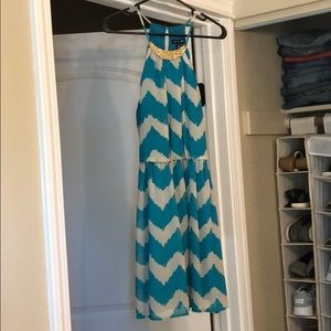 Patterned teal and gray dress.